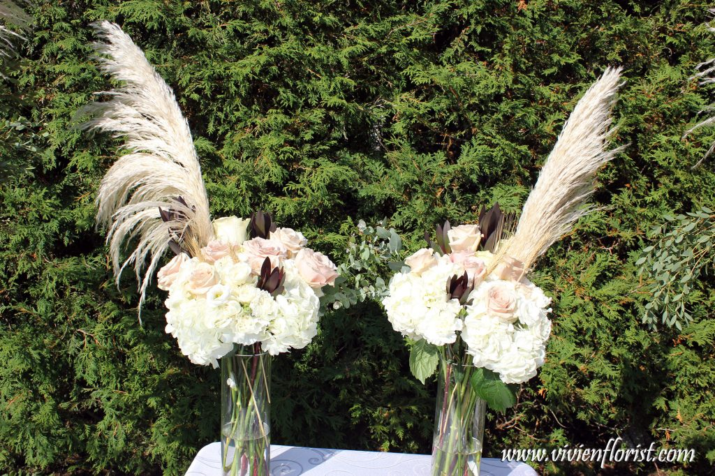 Wedding ceremony arch with pampas grass King Protea
