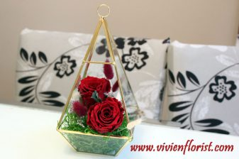 Red eternal roses in gold geometric vase for Montreal area