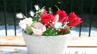 Red and pink eternal roses in clay vase for Montreal area
