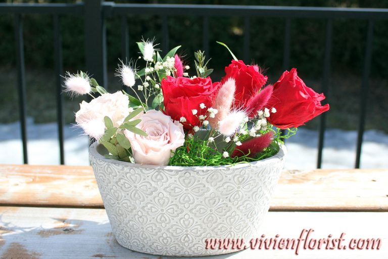 Red and pink eternal roses in clay vase