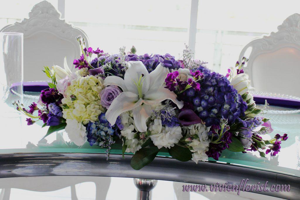 Glamorous lilies and hydrangeas wedding centerpiece Montreal